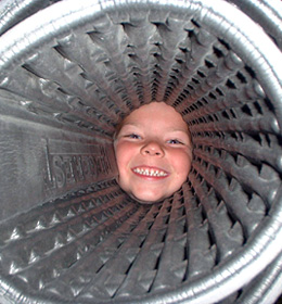 Boy looking through tube